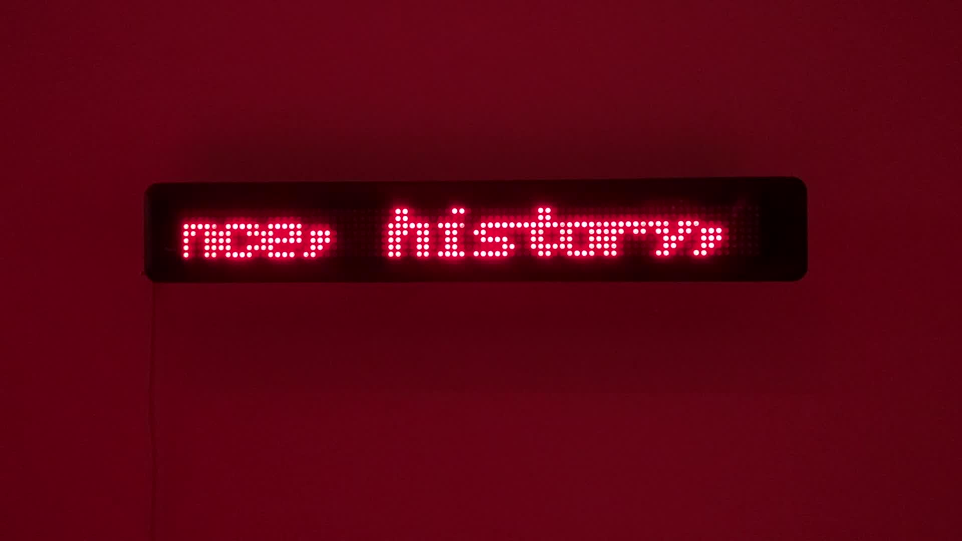 A view of an LED sign crawl of a text.