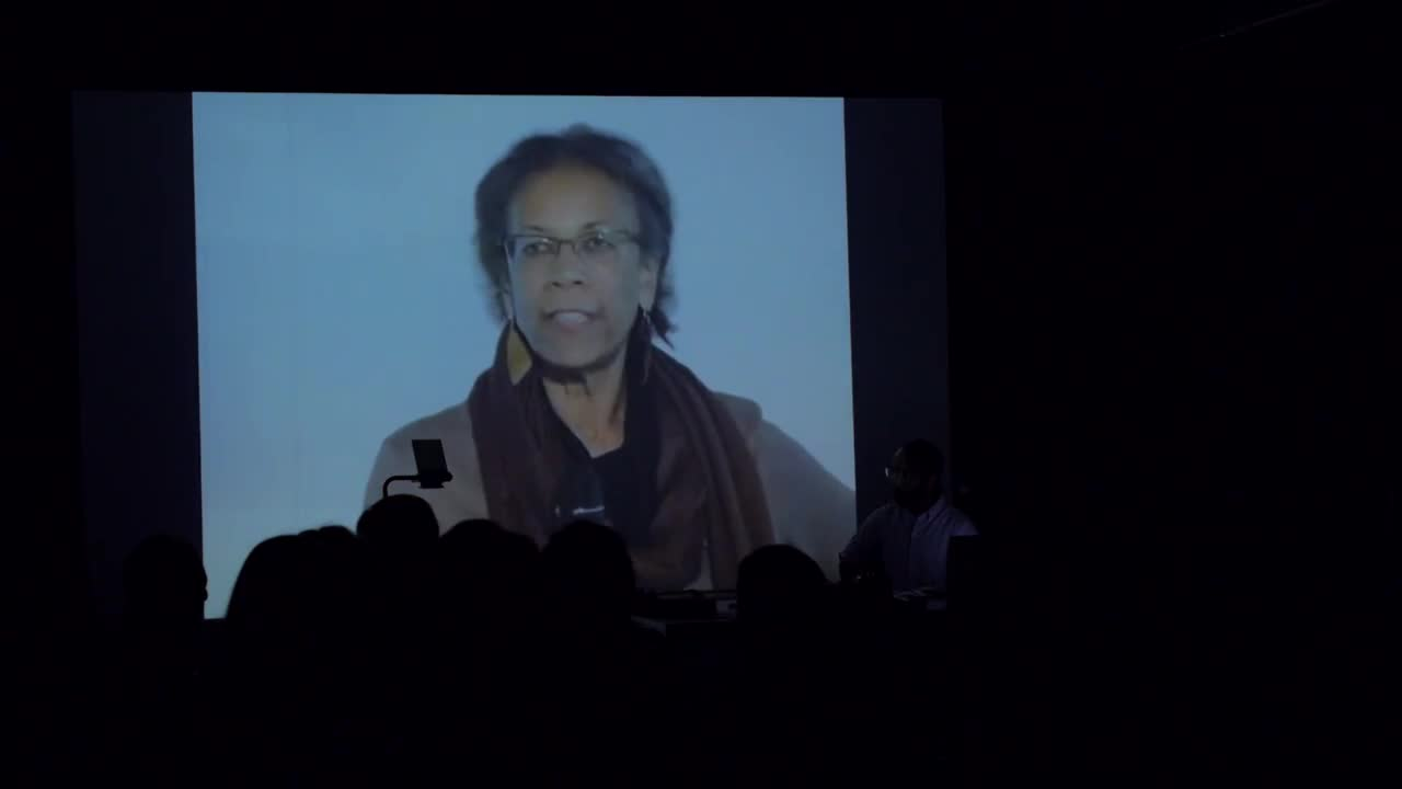 Video documentation of a mixed-media, audiovisual performance in front of a crowd.