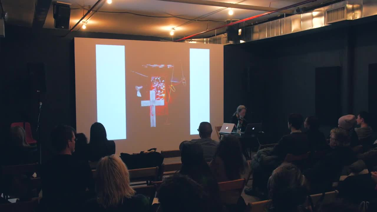 Video of a reading and discussion on the work of Jean Fisher, presented with a projected visual aid.