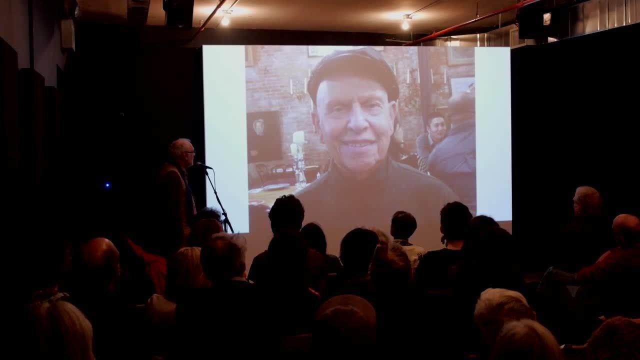 Video documentation of a talk given alongside a slide presentation.